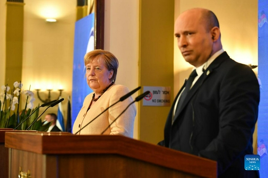Israeli Prime Minister Naftali Bennett (R) and German Chancellor Angela Merkel attend a joint press conference at the King David Hotel in Jerusalem, Oct. 10, 2021. Germany's outgoing Chancellor Angela Merkel kick-started her visit to Israel on Sunday morning, marking her final official trip to the country before she leaves office. (Photo by Yoav Dudkevitch/JINI via Xinhua)