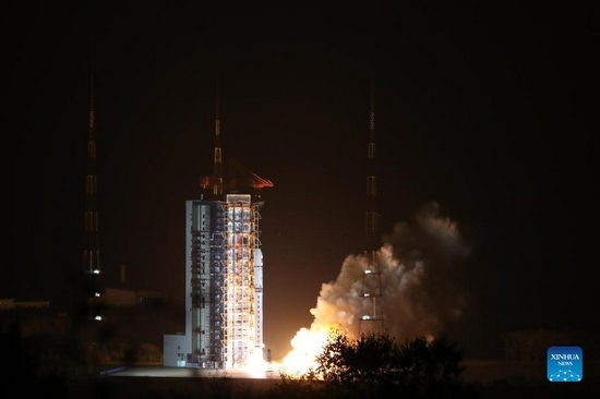 A Long March-2D rocket carrying China's first solar exploration satellite blasts off from the Taiyuan Satellite Launch Center in north China's Shanxi Province, Oct. 14, 2021. China sent its first solar exploration satellite into space from the Taiyuan Satellite Launch Center in north China's Shanxi Province at 6:51 p.m. Thursday (Beijing Time). The satellite was launched aboard a Long March-2D rocket and entered its planned orbit successfully. Ten small satellites including an orbital atmospheric density detection experimental satellite and a commercial meteorological detection constellation experimental satellite were also sent into space using the same carrier rocket. It was the 391st flight mission of the Long March carrier rocket series. (Photo by Zheng Bin/Xinhua)