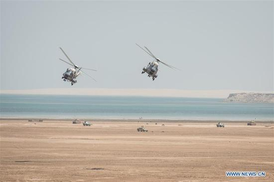 "Photo taken on April 14, 2018 shows helicopters during a ceremony show for the ""Gulf Shield Joint Exercise-1"" in eastern Saudi Arabia. Troops from 25 countries performed a live-ammunition drill in eastern Saudi Arabia on Saturday, one day before the 29th Arab League Summit. (Xinhua/Meng Tao)"