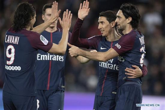 Angel Di Maria from Paris Saint-Germain celebrates his goal during the match against Monaco of French Ligue 1 2017-18 season 33rd round in Paris, France on April 15, 2018. Paris Saint-Germain won Monaco with 7-1 at home and won the championship. (Xinhua/Jack Chan)