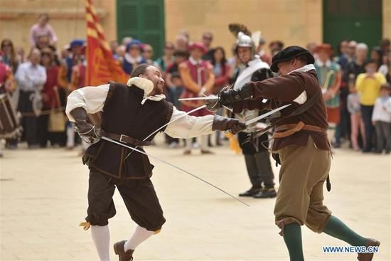 Re-enactors fight in a duel at Fort Saint Elmo, Valletta, Malta, on April 15, 2018. Heritage Malta opened Fort Saint Elmo and the National War Museum for free on Sunday to commemorate the 76th anniversary since the award of the George Cross to the Maltese Islands. (Xinhua/Mark Zammit Cordina)