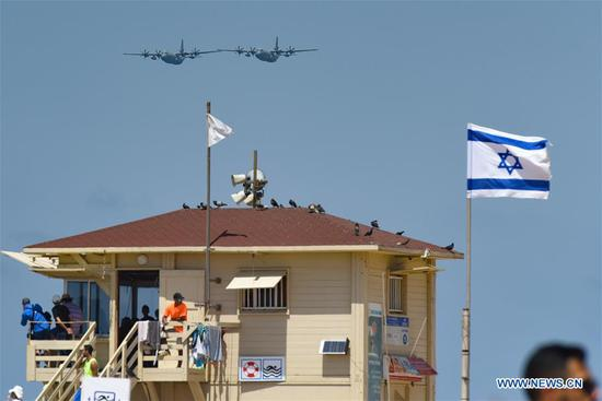 Aircraft perform during an air show celebrating Israel's 70th Independence Day in Tel Aviv, Israel, on April 19, 2018. (Xinhua/JINI)