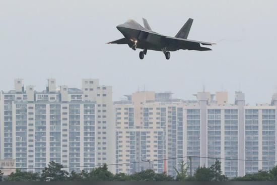 A US air force fighter jet flies over an apartment complex in Gwangju, South Korea, May 16, 2018. Reuters