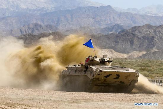 An armored vehicle operated by a Chinese crew drives during a match of the International Army Games 2018 in Korla, northwest China's Xinjiang Uygur Autonomous Region, Aug. 5, 2018. Three contests of the International Army Games 2018 in northwest China's Xinjiang Uygur Autonomous Region ended here Wednesday. (Xinhua/Wang Pengfei)