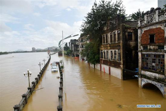 Photo taken on Sept. 18, 2018 shows a flooded street by the Mojiang River in Yangchun, south China's Guangdong Province. The city of Yangchun was hit by rainstorm after Super Typhoon Mangkhut ravaged Guangdong Province on Sunday. As of Tuesday, part of the city is still flooded, while disaster relief work is underway. (Xinhua/Zhou Ke)