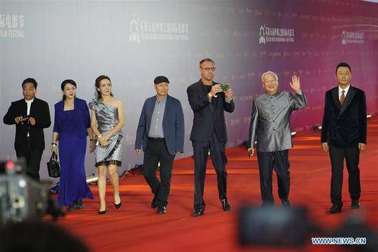 Jurors attend the opening ceremony of the 5th Silk Road International Film Festival in Xi'an, capital of China's Shaanxi Province, Oct. 8, 2018. The 5th Silk Road International Film Festival kicked off in Xi'an on Monday, with some activities hosted in its alternate counterpart Fuzhou of southeast China's Fujian Province. (Xinhua/Shao Rui)