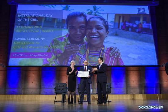 Chinese Vice Minister of Education and Director of the China National Commission for UNESCO Tian Xuejun (R), Deputy CEO of Misr El Kheir Foundation of Egypt Mohamed Abdelrahman (C) and UNESCO Assistant Director-General for Education Stefania Giannini pose for photos during an award ceremony for the 3rd UNESCO Prize for Girls' and Women's Education at UNESCO's headquarters in Paris, France, on Oct. 11, 2018. The Misr El Kheir Foundation of Egypt and the Women's Centre of Jamaica Foundation were awarded the 3rd UNESCO Prize for Girls' and Women's Education here on Thursday. (Xinhua/Chen Yichen)