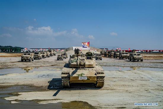 Photo taken on Nov. 7, 2018 shows armored vehicles after a dynamic display of ground military equipments at the 12th China International Aviation and Aerospace Exhibition (Airshow China) in Zhuhai, south China's Guangdong Province. (Xinhua/Yang Guang)