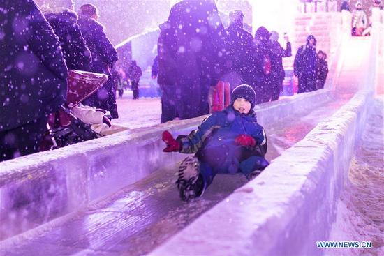 A child slides during Moscow ice festival in Moscow, Russia, on Jan. 3, 2019. Moscow ice festival opened in Victory Park from Dec. 29, 2018 to Jan. 13, 2019. (Xinhua/Bai Xueqi)