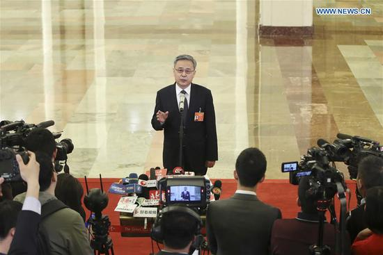 Guo Shuqing, chairman of the China Banking and Insurance Regulatory Commission, receives an interview after the opening meeting of the second session of the 13th National People's Congress at the Great Hall of the People in Beijing, capital of China, March 5, 2019. (Xinhua/Yin Gang)