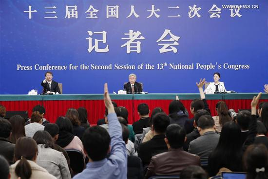 Liu Yongfu (C), director of the State Council Leading Group Office of Poverty Alleviation and Development, attends a press conference on the country's battle against poverty for the second session of the 13th National People's Congress in Beijing, capital of China, March 7, 2019. (Xinhua/Shen Bohan)