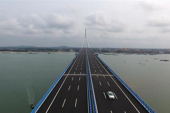 Cross-sea Haiwen Bridge officially starts operation in S China's Hainan