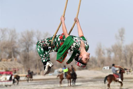 Uygur people participate in Shaghydi game in China's Xinjiang