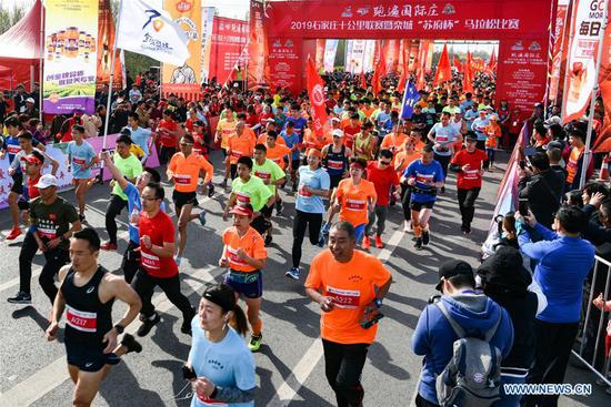 Runners take part in a marathon during the Qingming Festival holidays in Shijiazhuang, capital of north China's Hebei Province, April 7, 2019. (Xinhua/Li Mingfa)