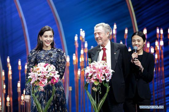 Actress Yang Ying (L) and actor Christopher Walken (C) recommend nominated films at the opening ceremony of the ninth Beijing International Film Festival in Beijing, capital of China, April 13, 2019. (Xinhua/Cai Yang)