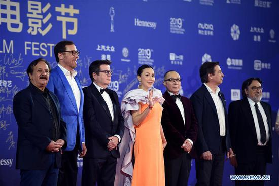 Jury members for the Tiantan Award are seen at the red carpet for the opening ceremony of the ninth Beijing International Film Festival in Beijing, capital of China, April 13, 2019. (Xinhua/Ju Huanzong)
