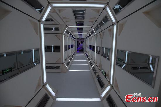 A view of a corridor inside the C-Space Project, a Mars simulation base in the Gobi Desert in Jinchang, Gansu Province, China, 17 April 2019. The C-Space Project Mars Base opened officially on 17 April 2019 with the aim to educate and provide an environment for youths and tourists to experience life on planet Mars. The base occupying an area of 11,996 square feet is situated about 40 kilometers from the town of Jinchang in the Gobi Desert. The location is chosen to simulate the landscape and harsh conditions of living on Mars as much as possible. (Photo/China News Service)