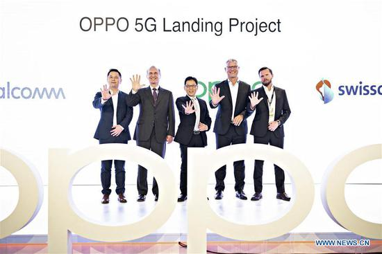 Photo taken on April 24, 2019 shows the launching ceremony of the Oppo Reno 5G smartphone in Zurich, Switzerland. Together with Switzerland's largest telecom company Swisscom, Chinese smartphone manufacturer Oppo launched its first 5G smartphone Reno 5G on Wednesday in Zurich. (Xinhua/Michele Limina)