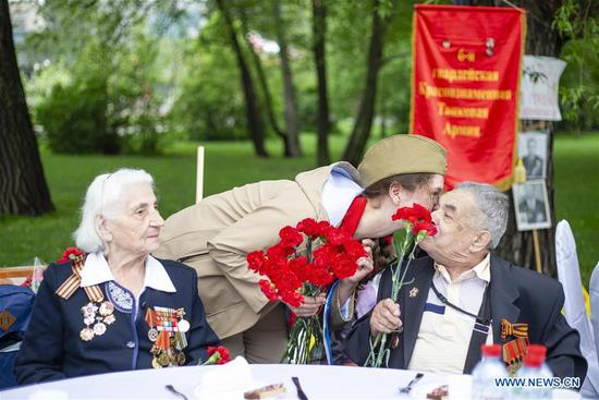 A girl presents flowers to World War II veterans during celebrations of the Victory Day in Moscow, Russia, on May 9, 2019. Russia marks the 74th anniversary of the victory over Nazi Germany in World War II here on May 9. (Xinhua/Alexander Zemlianichenko Jr)