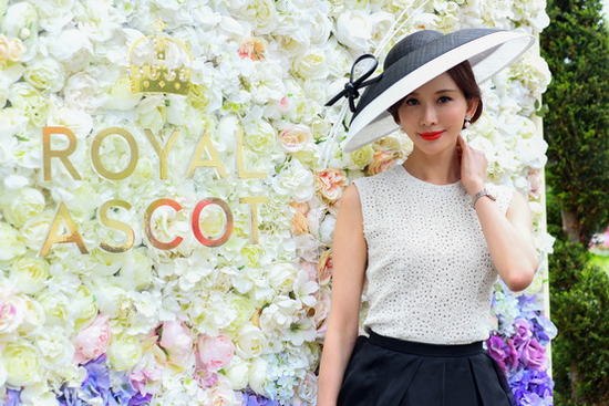 Racegoers wear colorful hats at Royal Ascot
