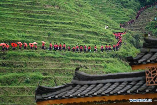 "People of Yao ethnic group attend the ""drying clothes"" festival in Longji Township of Longsheng County, south China's Guangxi Zhuang Autonomous Region, July 8, 2018. Local people of Yao ethnic group on Monday celebrated annual ""drying clothes"" festival, which falls on the 6th day of the 6th month of the Chinese traditional lunar calendar. (Photo by Huang Yongdan/Xinhua)"