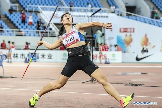Lyu Huihui competes during the women's javelin throw final at the 2019 China's National Athletics Tournament in Shenyang, northeast China's Liaoning Province, July 11, 2019. Lyu Huihui claimed the title with a new Asian record of 67.83 meters. (Xinhua/Pan Yulong)
