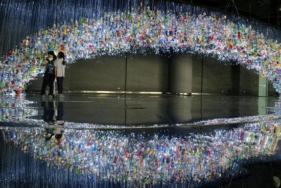 Artwork made of recycled plastic products exhibited in Shanghai