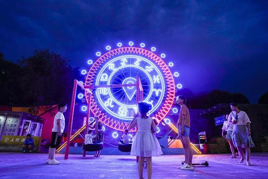 Night-time economy picks up in summer in NW China's Urumqi