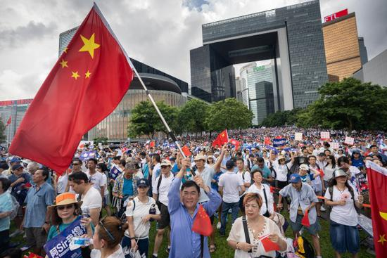 Hong Kong police arrest 5 people for national flag-insulting