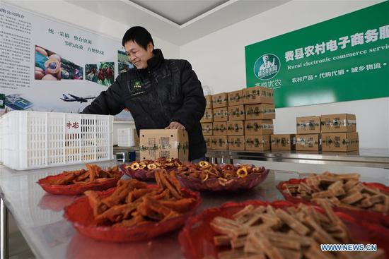 Villager Wang Yiping distributes goods through e-commerce platforms in Datianzhuang Village of Feixian County, east China's Shangdong Province, Jan. 23, 2018. Rural revitalization strategy was first put forward during the 19th National Congress of the Communist Party of China in 2017 and repeatedly stressed by the Chinese leadership since then. The strategy's overall goal is to build rural areas with thriving businesses, pleasant living environments, social etiquette and civility, effective governance, and prosperity. (Xinhua/Xing Guangli)