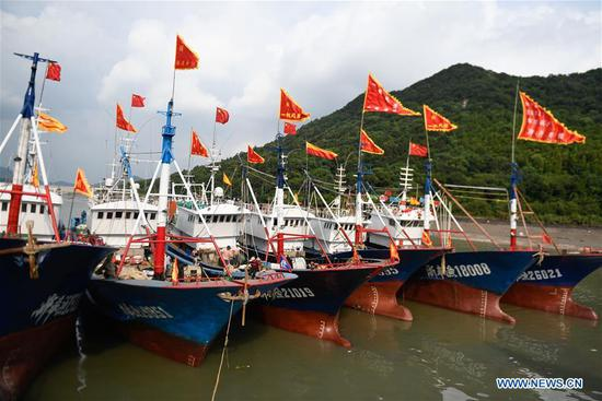 Fishing boats are seen waiting for fishing at a port of Tongzhao Village in Fenghua District of Ningbo City, east China's Zhejiang Province, Sept. 15, 2019. A celebration marking the launching of a fishing season was held here to pray for good luck. The annual summer fishing ban on the East China Sea will end on Sept. 16. (Xinhua/Huang Zongzhi)