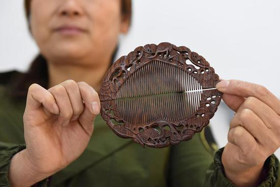 Intangible cultural heritage of Anhui Province: traditional handmade Langqiao wooden comb