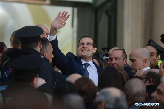 Robert Abela (C) waves to supporters in Valletta, Malta, on Jan. 13, 2020. Robert Abela, the newly-elected leader of Malta's Labor Party, was officially sworn in as Prime Minister on Monday at a ceremony at the President's Palace in Valletta. (Photo by Jonathan Borg/Xinhua)