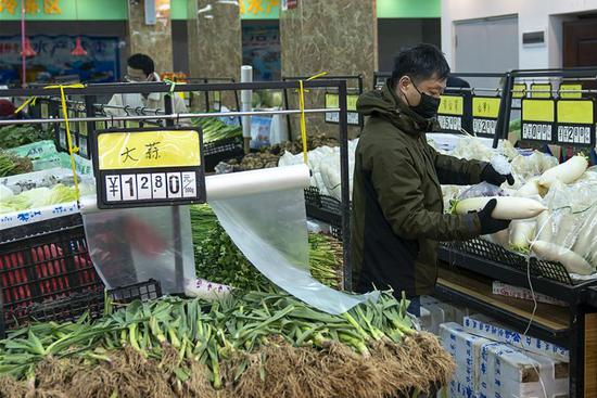 Residents in Wuhan continue lives as efforts made to control novel coronavirus outbreak