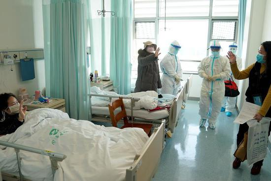 Coronavirus patient discharged from hospital after recovery in Wuhan