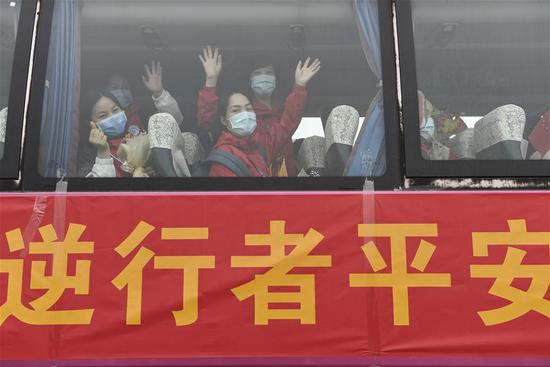 A vehicle carrying medics supporting virus-hit Hubei Province leaves Nanning Wuxu International Airport in Nanning, south China's Guangxi Zhuang Autonomous Region, March 20, 2020. The second batch of the medical assistance team from Guangxi, which consist of 136 members, had left Hubei Province, as the epidemic outbreak in the hard-hit province has been subdued. (Xinhua/Cao Yiming)