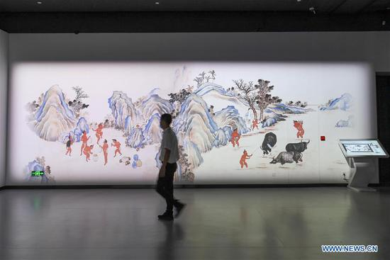 A visitor tours the digital exhibition hall of Hainan Museum in Haikou, south China's Hainan Province, May 18, 2020. The digital exhibition hall of Hainan Museum opened on Monday, the International Museum Day. (Xinhua/Pu Xiaoxu)