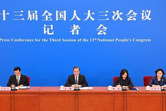 In pics: Chinese FM meets press on foreign policy, relations