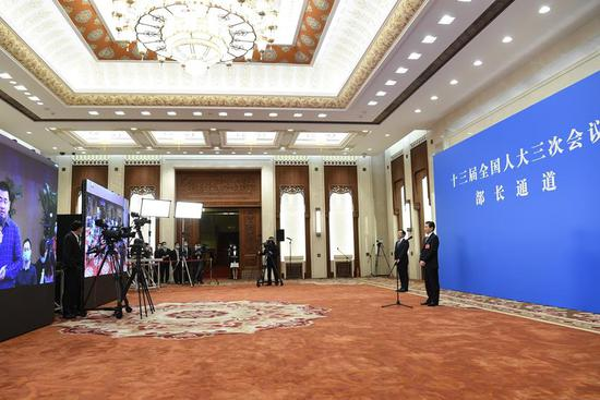 Ministers receive interview after 2nd plenary meeting of 3rd session of 13th NPC
