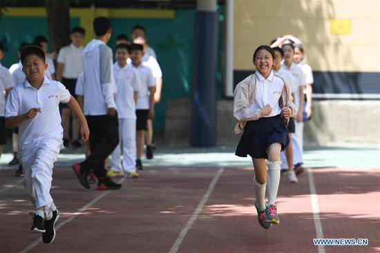 Students have a physical education class in Beijing, capital of China, June 1, 2020. Students at their first and second grades of senior high schools, first and second grades of junior high schools and sixth grade of primary schools returned to school for this semester in Beijing on Monday. (Xinhua/Ju Huanzong)