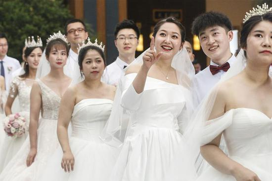 Group wedding ceremonies held for newly-married couples who once aided COVID-19 fight