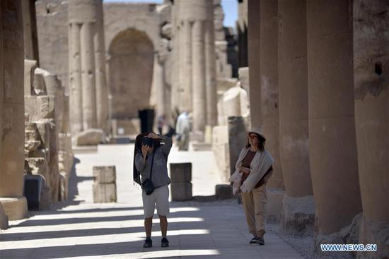 Tourists visit Temple of Luxor in Luxor, Egypt, on July 1, 2020. Egypt reopened on Wednesday the Egyptian Museum, the Giza Pyramids, and Temple of Luxor for the first time since the COVID-19 closure in March. (Str/Xinhua)