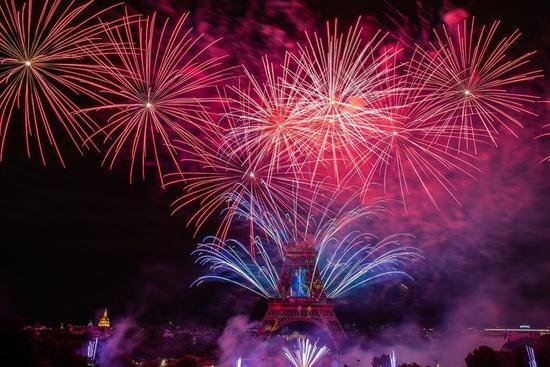 Fireworks light up sky over Eiffel Tower to celebrate Bastille Day