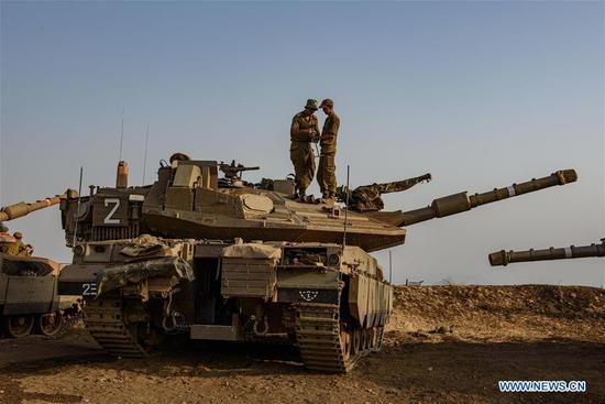 Israeli soldiers are seen on tanks in the Israel-occupied Golan Heights next to Blue Line, a border demarcation drawn in 2000 by the United Nations after Israel withdrew its forces from southern Lebanon, July 28, 2020. Lebanese leaders on Tuesday warned against heightened border tensions with Israel, while slamming Israel for attacking southern Lebanon a day earlier, LBCI local TV channel reported. (Ayal Margolin/JINI via Xinhua)