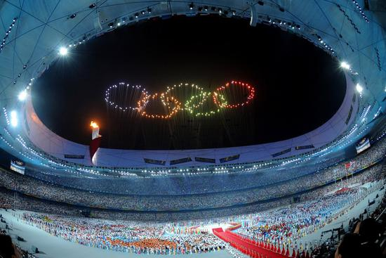 Photo taken on Aug. 8, 2008 shows fireworks in the shape of the Olympic rings during the opening ceremony of the Beijing Olympic Games held in the National Stadium, also known as the Bird's Nest, in Beijing. (Xinhua/Ma Zhancheng)