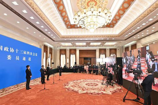 CPPCC members receive interview ahead of 2nd plenary meeting of 4th session of 13th CPPCC National Committee
