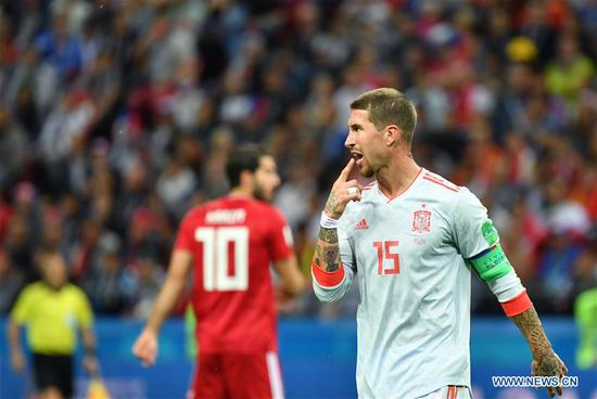 Sergio Ramos (R) of Spain reacts during a Group B match between Spain and Iran at the 2018 FIFA World Cup in Kazan, Russia, June 20, 2018. (Xinhua/Liu Dawei)