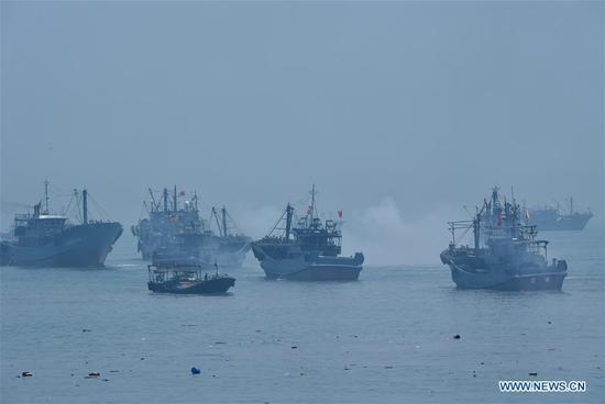 Fishing boats depart for fishing in Xiangzhi Town in Shishi City, southeast China's Fujian Province, Aug. 1, 2018. Fishing boats are ready to fish after the three-month fishing ban in Fujian. (Xinhua/Jiang Kehong)