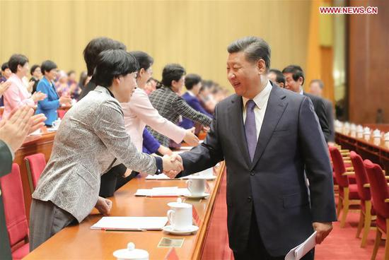 Chinese President Xi Jinping, also general secretary of the Communist Party of China (CPC) Central Committee and chairman of the Central Military Commission, shakes hands with delegates to the 12th National Women's Congress (NWC) in Beijing, capital of China, Oct. 30, 2018. (Xinhua/Ju Peng)
