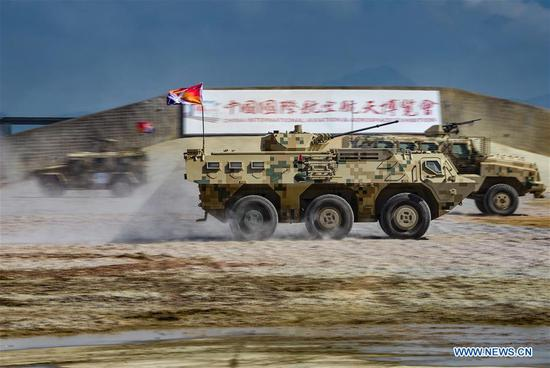 Armored vehicles attend a dynamic display of ground military equipments at the 12th China International Aviation and Aerospace Exhibition (Airshow China) in Zhuhai, south China's Guangdong Province, on Nov. 7, 2018. (Xinhua/Yang Guang)